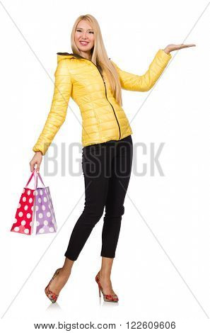 Caucasian woman in yellow jacket holding plastic bags isolated o