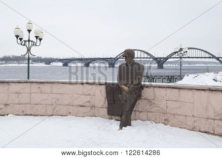 Rybinsk, Russia - March 6, 2016: The monument to the Soviet poet Lev Oshanin on the Volga embankment. Popular touristic landmark.