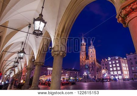 Visiting Cracow Poland. Krakow Old Town Sukiennice Marketplace and the St. Mary's Church. Mariacki Church.