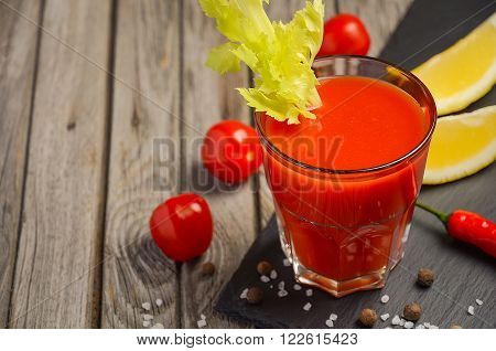 Bloody Mary cocktail. Rustic background. Horizontal permission. Selective focus. Copy space.