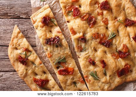 Italian Focaccia With Sun-dried Tomatoes Close Up. Horizontal Top View