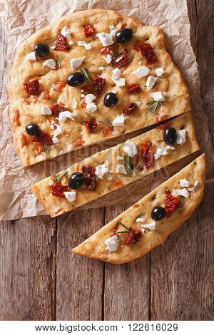 Focaccia With Dried Tomatoes, Feta And Olives. Vertical Top View