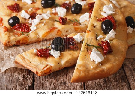 Focaccia With Dried Tomatoes, Feta And Olives. Macro Horizontal