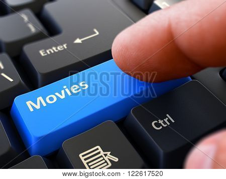 Movies - Written on Blue Keyboard Key. Male Hand Presses Button on Black PC Keyboard. Closeup View. Blurred Background. 3D Render.