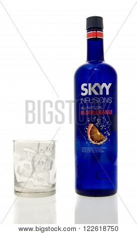 Winneconne WI - 15 March 2016: A bottle of Skyy Infusions blood orange vodka with a glass of ice