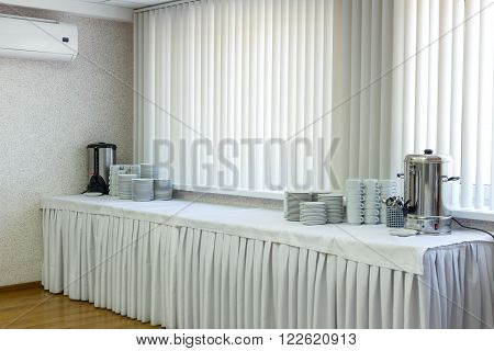 Generic view of catering banquet table in hall next to conference room