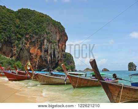 Tropical beach traditional long tail boats Andaman Sea Thailand
