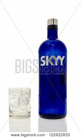 Winneconne WI - 15 March 2016: A bottle of Skyy vodka with a glass of ice