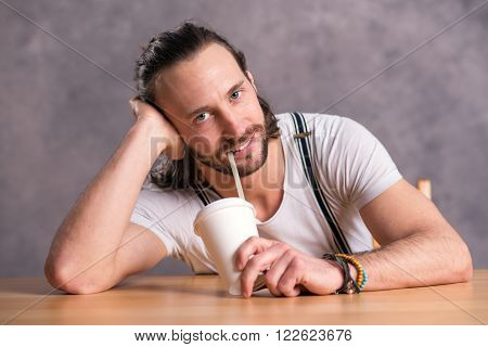 Young Man Drinking Soft Drink