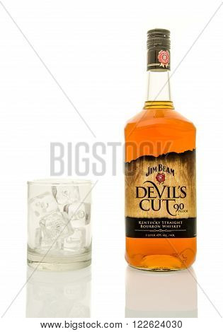 Winneconne WI - 19 March 2016: A bottle of Jim Beam Devil's cut whisky with a glass of ice.