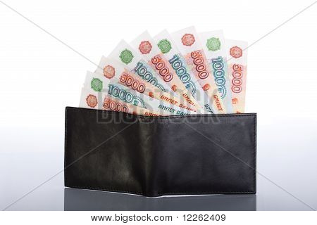 thousands of roubles in black leather wallet