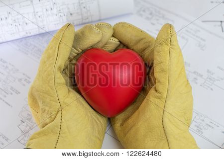 Safety gloves holding a heart. Love for safety