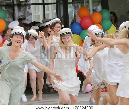 STOCKHOLM SWEDEN - JUN 10 2015: Group of happy teenage girls running out from school after graduation from high school at the school Globala gymnasiet June 10 2015 Stockholm Sweden