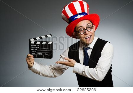 Man with american hat and movie board