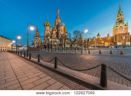 Moscow Russia - March 14 2016: the St. Basil Cathedral and Spasskaya tower in red square in the evening twilight.