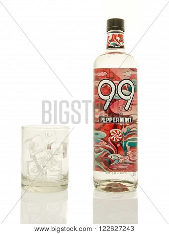 Winneconne WI - 19 March 2016: A bottle of 99 proof peppermint liqueur with a glass of ice.