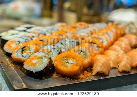 Row of Traditional Japanese sushi and sasimi