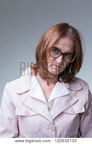 Unhappy older elegant mother-in-law with mean look