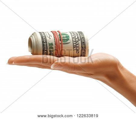 Hand holding bundle of one hundred US dollars banknotes isolated on white background. Business concept
