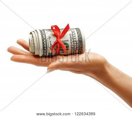 Money with red ribbon in womens hand isolated on white background. Business concept