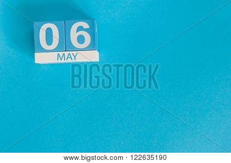 May 6th. Image of may 6 wooden color calendar on blue background.  Spring day, empty space for text.
