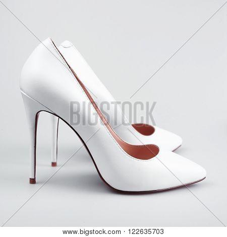 white female Elegant shoes on the white