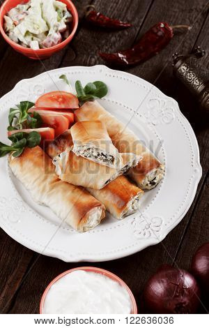 Pita zeljanica, balkans phyllo pastry rolls filled with cheese and spinach or chard