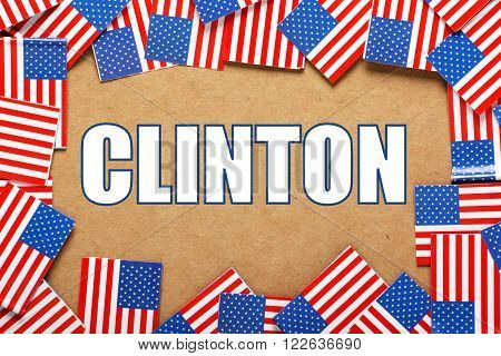 The name of United States Presidential candidate for the Democrat party, Clinton surrounded by a border of American flags
