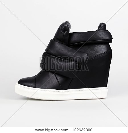 Stylish leather boots in a white background