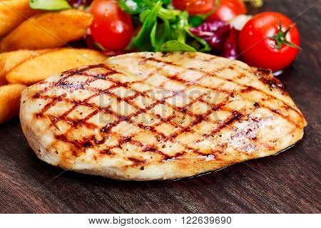 Grilled Chicken breast. with potato and vegetables.