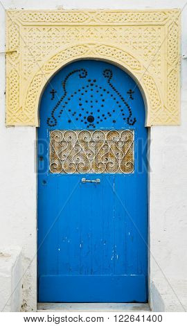 Blue Door With Ornament And Arch From Sidi Bou Said In Tunisia
