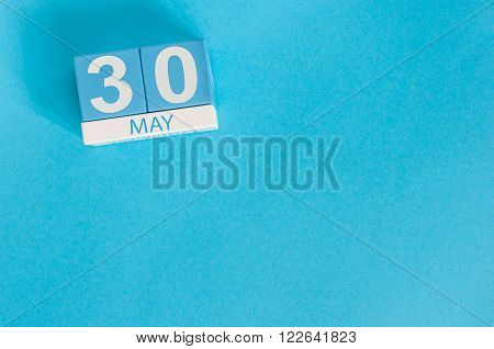 May 30th. Image of may 30 wooden color calendar on blue background.  Spring day, empty space for text.