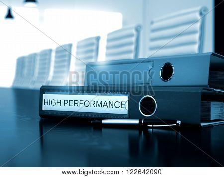 High Performance - Ring Binder on Office Desktop. File Folder with Inscription High Performance on Black Working Desktop. 3D Render.