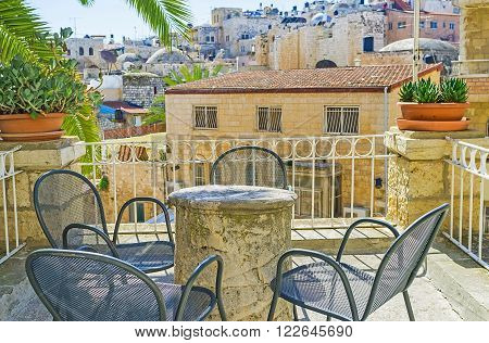 JERUSALEM ISRAEL - FEBRUARY 16 2016: The cozy terrace of the Austrian Hospice with the panoramic view on the old housing of the Muslim Quarter of Jerusalem on February 16 in Jerusalem.