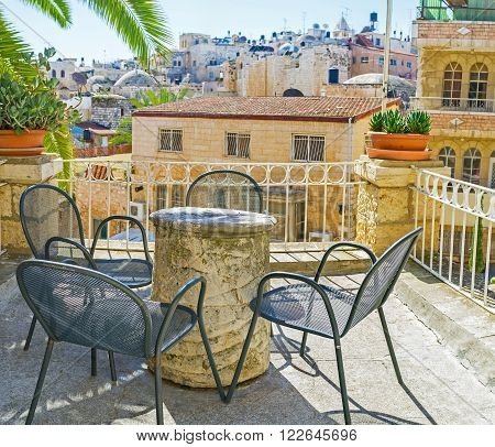 JERUSALEM ISRAEL - FEBRUARY 16 2016: The street terrace overlooking the city roofs is the best place to relax in shade Jerusalem on February 16 in Jerusalem.
