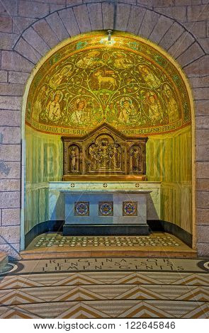 JERUSALEM ISRAEL - FEBRUARY 16 2016: The side altar in Dormition Church with the semidome covered with the golden mosaics on February 16 in Jerusalem.