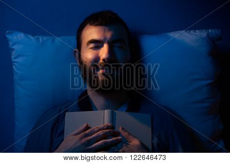 Smiling Man Sleeping with a Book on His Chest