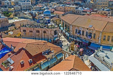 The aerial view on the Muristan Square and narrow streets of the Aftimos Bazaar from the bell tower of the Lutheran Kirche of the Redeemer Jerusalem Israel.