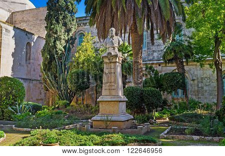 JERUSALEM ISRAEL - FEBRUARY 16 2016: The monument to Cardinal Lavigerie in shady garden of St Anne Church located at the beginning of Via Dolorosa in Muslim Quarter on February 16 in Jerusalem.
