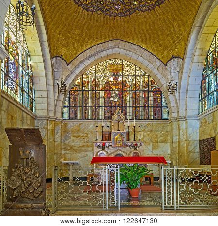 JERUSALEM ISRAEL - FEBRUARY 16 2016: The altar of the Church of the Flagellation with the scenic stained-glass window decorated with icon on February 16 in Jerusalem.