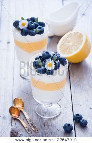 Lemon Blueberry dessert on a wooden background