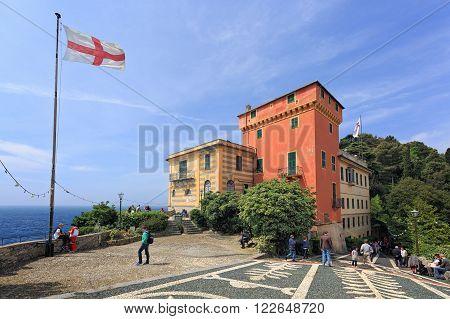 PORTOFINO ITALY - MAY 2 2015: Tourists in Portofino Italy. Chiesa San Giorgio (Catholic Church)