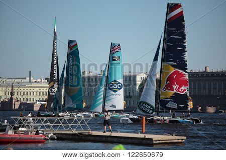 ST. PETERSBURG, RUSSIA - AUGUST 23, 2015: Extreme 40 catamarans before the last day of St. Petersburg stage of Extreme Sailing Series. The Wave, Muscat team of Oman leading after 3 days