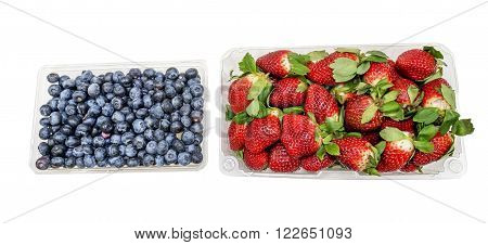 Container full with fresh Blueberries and Strawberries