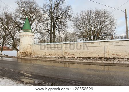 Staraya Ladoga, Russia - 23 February, The wall of the monastery by the roadside, 23 February 2016. Tourist places in the great ancient route from the Vikings to the Greeks.Staroladozhsky Holy Assumption nunnery. Gold ring of Russia.