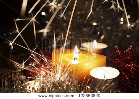 Christmas candles and sparks on a dark background