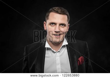 Drunk angry man on a dark background.