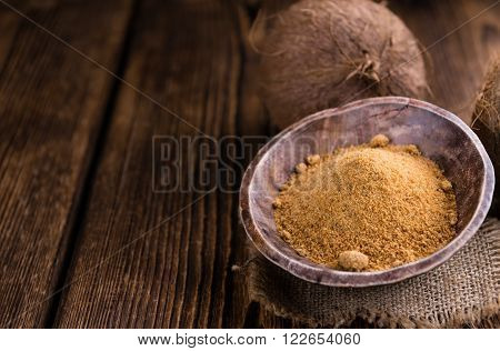Coconut Palm Sugar (selective focus) on an old wooden table