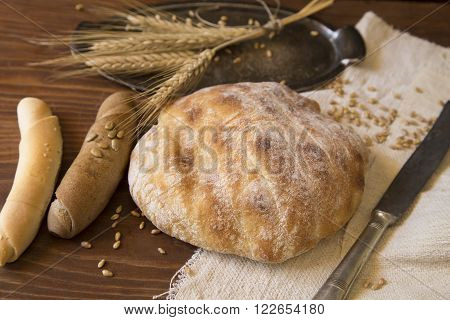 Home made bread and rolls on wooden background