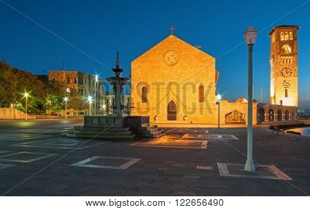 Greece, Rhodes - July 13 Evangelizmos Church (Church of the Annunciation) and a fountain on July 13, 2014 in Rhodes, Greece